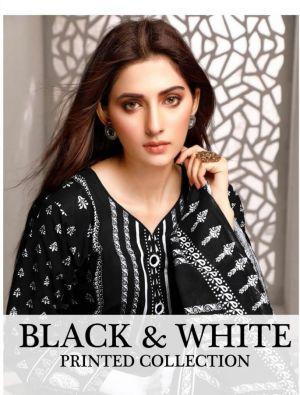 Saffron Black And White Printed Cotton Dress Material